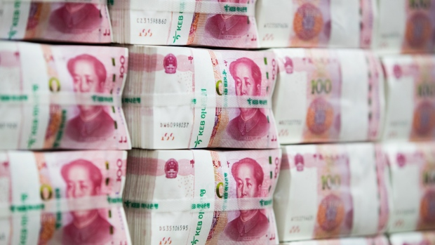 Genuine bundles of Chinese one-hundred yuan banknotes are arranged for a photograph at the Counterfeit Notes Response Center of KEB Hana Bank in Seoul, South Korea, on Monday, Aug. 14, 2017. China's factory output and investment slowed somewhat in July, according to data released today, yet the yuan appeared not to take the data as negative, if in fact it's paying attention to it at all.