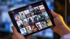 A selection of Netflix Inc. original content sits displayed in the Netflix app on an Apple Inc. iPad tablet device in this arranged photograph in London, U.K., on Monday, Aug. 20, 2018.