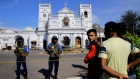 Sri Lankans gather outside St. Anthony's Shrine a day after the series of blasts, in Colombo.