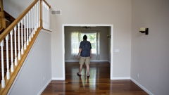 A prospective home buyer tours a house for sale in Dunlap, Illinois.