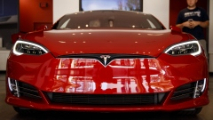 A Tesla Inc. Model S electric vehicle is displayed at the company's showroom in Newport Beach, California, U.S., on Friday, July 6, 2018. Tesla Inc. reached a milestone critical to Elon Musk's goal to bring electric cars to the masses -- and earn some profit in the process -- by finally exceeding a long-sought production target with the Model 3.