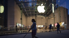 Pedestrians pass in front of the Apple Inc. store on Manhattan's Upper West Side in New York.