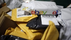 A parcel in eBay Inc. packaging is seen on a conveyor belt with other small parcels at the United States Postal Service (USPS) sorting center in Louisville, Kentucky, U.S., on Friday, Jan. 13, 2017. Starting January 22, the cost of mailing a one-ounce first-class letter will return to being 49 cents, up from 47 cents, where it had been since April.