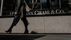Pedestrians pass in front of a JPMorgan Chase & Co. office building in New York.