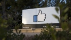 Signage is displayed outside Facebook Inc. headquarters in Menlo Park, California.