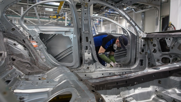 "A worker assembles Mercedes-Benz E-Class automobiles on the production line at the Daimler AG luxury automobile plant in Moscow, Russia, on Friday, April 19, 2019. Daimler Chief Executive Officer Dieter Zetsche called Russia ""an important market for us where we always worked very profitably."" He told Bloomberg after the event, ""We do believe there is significant growth potential here."""
