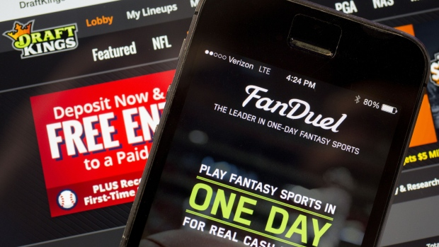 The FanDuel Inc. app and DraftKings Inc. website are arranged for a photograph in Washington, D.C., U.S.