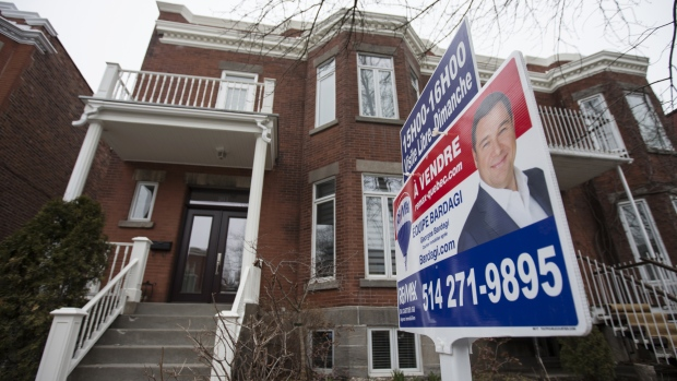 "A ""For Sale"" sign is displayed outside a home in the Outremont borough of Montreal, Quebec, Canada, on Saturday, April 14, 2018. An economic revival in Canada's second-biggest city is fueling a real-estate renaissance, speeding up sales, shrinking inventories, and luring foreign buyers."