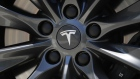 A Tesla logo sits on the wheel hub of a Tesla Inc. Model S electric vehicle at a Supercharger station in Egerkingen, Switzerland, on Thursday, Aug. 16, 2018.