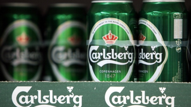 Cans of Carlsberg lager beer, produced by Carlsberg A/S, sit on display at a supermarket in London, U.K.