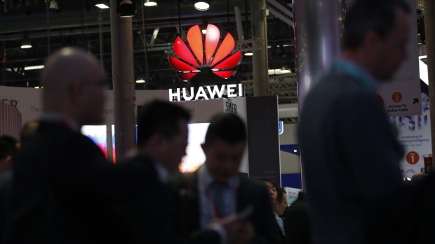 An illuminated logo hangs above the Huawei Technologies Co. pavilion on the opening day of the MWC Barcelona in Barcelona, on Feb. 25.