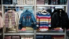 Children's clothing hangs on display for sale at a Gap Inc. store in New York, U.S., on Wednesday, Dec. 13, 2017. Bloomberg is scheduled to release consumer comfort figures on December 21.