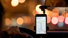A driver uses an Uber Technologies Inc. car service app on a mobile device while driving in Washington, D.C., U.S., on Wednesday, Nov. 29, 2017. Uber Technologies Inc.'s net loss widened to $1.46 billion in the third quarter, according to people with knowledge of the matter, as the ride-hailing leader struggled to fend off competition, legal challenges and regulatory scrutiny.