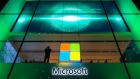 A Salesforce.Com Inc., left, and a Microsoft Corp. logo, center, hang beside an illuminated iCloud icon at the CeBIT 2017 tech fair in Hannover, Germany, on Sunday, March 19, 2017. Leading edge technologies in the digital world are showcased in this annual event which runs March 20 - 24.