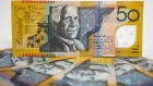 Australian fifty dollar banknotes are arranged for a photograph in Australia.