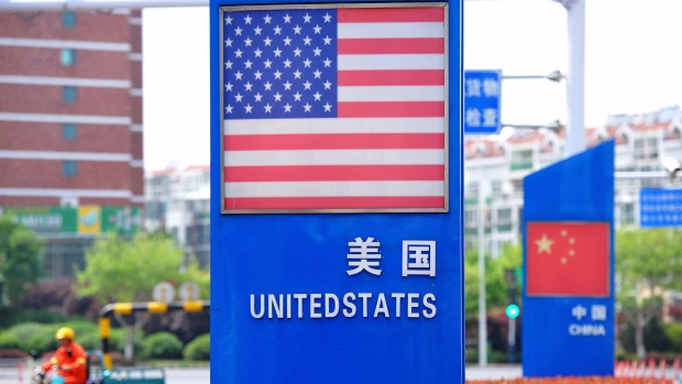 U.S. and Chinese flags in a special trade zone in Qingdao in eastern China's Shandong province
