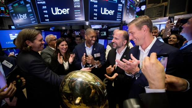 Garrett Camp, co-founder of Uber Technologies, from left, Stacey Cunningham, president of the NYSE Group, Tony West, chief legal officer of Uber, Dara Khosrowshahi, chief executive officer of Uber, and Ryan Graves, co-founder of Uber Technologies Inc., celebrate during the company's IPO on the floor of the New York Stock Exchange on Friday, May 10, 2019.
