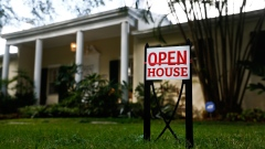 "An ""Open House"" sign is displayed outside of a home for sale in Miami, Florida, U.S."