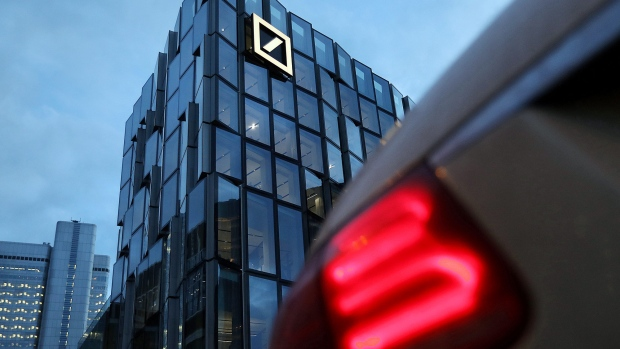 The Deutsche Bank AG logo sits on the bank's campus office building in Frankfurt, Germany, on Thursday, Jan. 31, 2019. On the eve of fourth-quarter results that are likely to reflect its troubles, Deutsche Bank AG's ability to avoid a government-brokered merger with Commerzbank could rest on its performance in the first quarter of 2019, according to people briefed on the thinking of its top executives.
