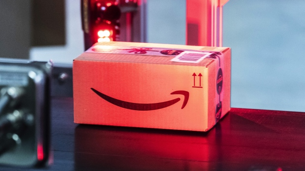 The Amazon.com Inc. logo sits on a box as it passes under a scanner inside an Amazon.com Inc. fulfilment center in Koblenz, Germany, on Friday, Nov. 23, 2018. Germans are expected to buy about 2.4 billion euros worth of goods on Black Friday and Cyber Monday, an increase of about 15 percent over last year.