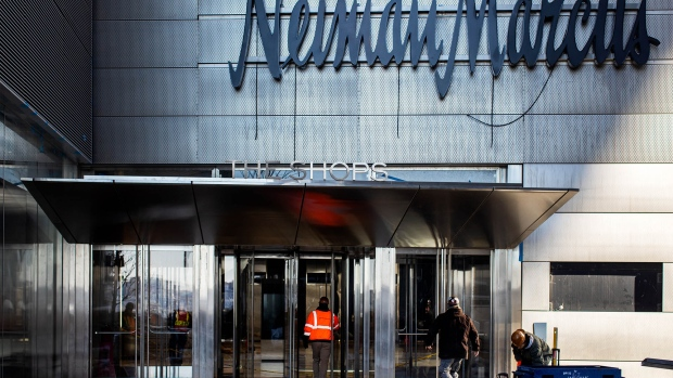 A contractor enters the Neiman Marcus store at the Hudson Yards development in New York.