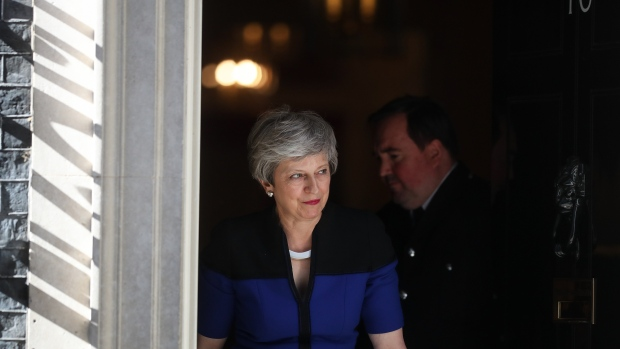 Theresa May, U.K. prime minister, walks to greet Jens Stoltenberg, secretary general of the North Atlantic Treaty Organization (NATO), ahead of their bilateral meeting at number 10 Downing Street in London, U.K., on Tuesday, May 14, 2019. May's Cabinet agreed on Tuesday morning to press on with cross-party talks with Labour, Prime Ministers Spokesman James Slack told reporters. Photographer: Simon Dawson/Bloomberg