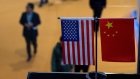Chinese and US flag at a booth during the first China International Import Expo (CIIE) in Shanghai.