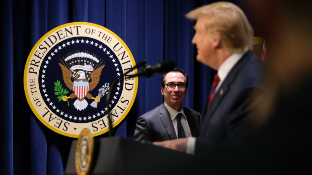 Steven Mnuchin listens to Donald Trump during a conference in April. Photographer: Alex Wroblewski/Bloomberg