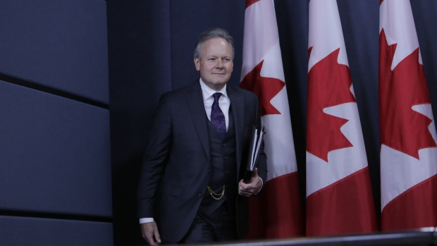 Stephen Poloz, governor of the Bank of Canada, arrive for a news conference at the National Press Theater in Ottawa, Ontario, Canada, on Wednesday, Oct. 25, 2017.