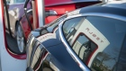 Tesla Inc. electric automobiles sit charging at a Tesla Supercharger station in Zaltbommel, Netherlands, on Monday, April 1, 2019. With 5,315 new cars registered, Tesla's Model 3 accounted for 29 percent of the new sales.