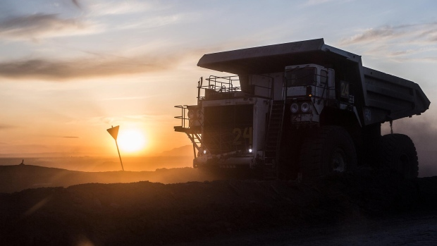 The sun sets over a dump truck