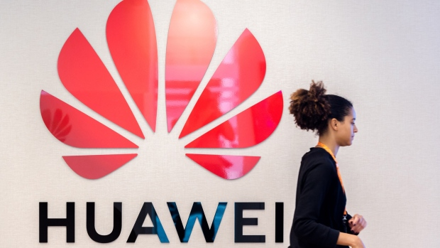 The Huawei Technologies Co. logo sits on a wall at the company's Cyber Security Transparency Centre in Brussels, Belgium, on Tuesday, May 21, 2019. Huawei is prepared to sign European agreements guaranteeing its telecoms technology will not be used for espionage, Huawei Chief EU Representative Abraham Liu said.
