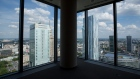 Towers stand on the city skyline seen from unoccupied office space in central Warsaw, Poland, on Monday, June 16, 2014. Poland may be forced to hold an early ballot as a scandal over leaked recordings of conversations among officials roils the nation, Prime Minister Donald Tusk said.