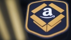 The Amazon.com logo is seen during the company's job fair in Kenosha, Wisconsin, U.S., on Wednesday, Aug. 2, 2017. The U.S. Department of Labor is scheduled to release initial jobless claims figures on August 3.
