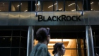 Pedestrians walk past BlackRock Inc. headquarters in New York.