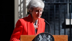 British Prime Minister Theresa May reacts after making a speech in the street outside 10 Downing.