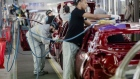 Employee carry out final inspections on the body shells of freshly painted Nissan Micra, right, and Renault Clio, second left, automobiles inside the Renault SA factory in Flins, France, on Thursday, Feb. 23, 2017. Carlos Ghosn, one of the auto industry's most celebrated turnaround artists, is relinquishing his CEO role at Nissan Motor Co. and turning over day-to-day control to Hiroto Saikawa as he focuses on strengthening the carmaker's alliance with Renault and Mitsubishi Motors Corp.