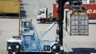 A worker operates a loaded container handler to move a shipping container at the APM shipping terminal in the Port of Los Angeles in Los Angeles, California, U.S., on Tuesday, May 7, 2019. The terminal is planning to replace diesel trucks and human workers. It has already ordered an electric, automated carrier from Finnish manufacturer Kalmar, part of the Cargotec Corp., that can fulfill the functions of three kinds of manned diesel vehicles: a crane, top-loader and truck.