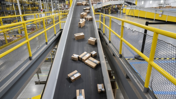Packages ready for shipment move down a conveyor belt at the Amazon.com Inc. fulfillment center in Baltimore, Maryland, U.S., on Tuesday, April 30, 2019.