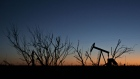 The silhouette of a pumpjack is seen at dusk in the Permian Basin near Midland, Texas, U.S., on Friday, March 2, 2018. Chevron, the world's third-largest publicly traded oil producer, is spending $3.3 billion this year in the Permian and an additional $1 billion in other shale basins. Its expansion will further bolster U.S. oil output, which already exceeds 10 million barrels a day, surpassing the record set in 1970.