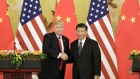 U.S. President Donald Trump, left, and Xi Jinping, China's president, shake hands during a news conference at the Great Hall of the People in Beijing, China, on Thursday, Nov. 9, 2017.