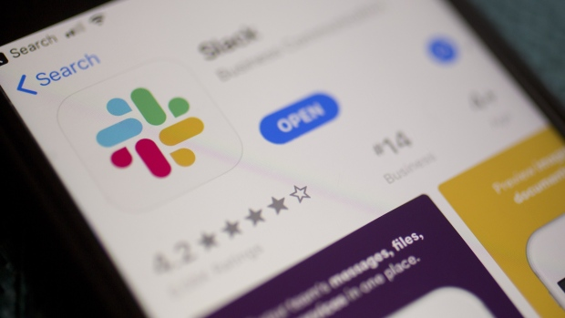 The Slack Technologies Inc. application is displayed in the App Store on an Apple Inc. iPhone in an arranged photograph taken in Arlington, Virginia, U.S. on Monday, April 29, 2019. Slack's filing last week confirms its plans to avoid a traditional public offering and instead list its shares directly on the New York Stock Exchange under the symbol SK.