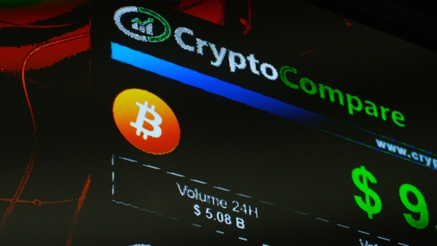 The symbols of Bitcoin and Ethereum cryptocurrencies sit displayed on a screen during the Crypto Investor Show in London, U.K., on Saturday, March 10, 2018. The meeting is the largest crypto and blockchain event for investors in the U.K.