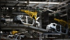Painted Renault Captur crossover sport utility vehicle (SUV) body shells travel along a conveyor on the production line inside the Renault SA automobile plant in Moscow, Russia, on Tuesday, May 28, 2019. A prospective deal proposed by Fiat Chrysler Automobiles NV to merge with Renault could create the world's third-biggest carmaker.