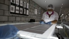 An employee solders photovoltaic panels at a Solartec SA renewable energy assembly plant in Irapuato, Mexico.