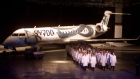 Employees march out the new Bombardier CRJ700 during roll out ceremonies, May 28, 1999, Montreal