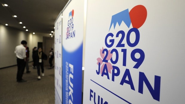 Banners for the Group of 20 (G-20) finance ministers and central bank governors meeting stand outside the media center of the meeting in Fukuoka, Japan, on Saturday, June 8, 2019. The challenges of raising tax from the digital economy was the focus of a session with finance ministers from China, France, Japan, Indonesia, Britain and the U.S.