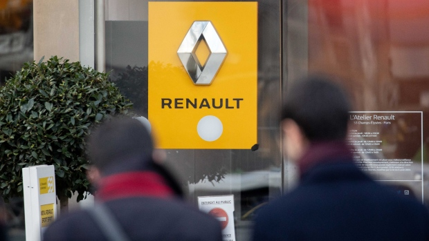 A sign sits outside the Renault SA flagship store on the Champs Elysee in Paris, France, on Monday, Nov. 19, 2018. Chairman Carlos Ghosn, a towering figure who saved Nissan Motor Corp. from collapse and brought it together with Renault and Mitsubishi Motors Corp., was detained Monday in Tokyo over the suspected breach of Japanese financial laws, Nissan Chief Executive Officer Hiroto Saikawa told reporters in Yokohama, Japan.
