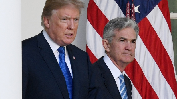 U.S. President Donald Trump, left, and Jerome Powell, governor of the U.S. Federal Reserve and Trump's nominee as chairman of the Federal Reserve, walk out to a nomination announcement in the Rose Garden of the White House in Washington, D.C., U.S., on Thursday, Nov. 2, 2017. If approved by the Senate, the 64-year-old former Carlyle Group LP managing director and ex-Treasury undersecretary would succeed Fed Chair Janet Yellen. Photographer: Olivier Douliery/Bloomberg