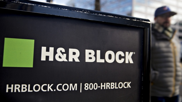 Signage is displayed outside the H&R Block Inc. tax service office in Washington, D.C.